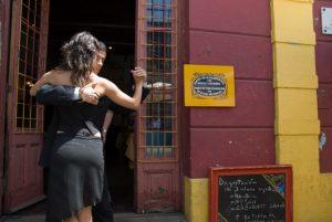 A couple dances in front of a café, La Boca, Buenos Aires. Photo: Darrin Ratajczak.